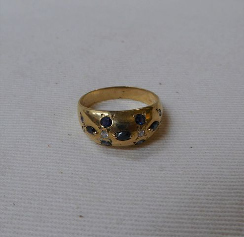 Bague or jaune sertie pierres couleur bleu/blanc Pds 4 grs