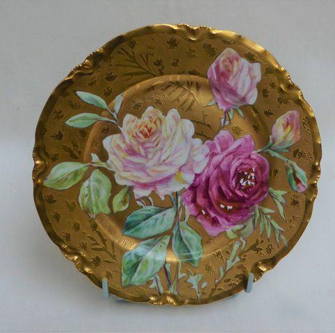 Limoges HAVILAND Assiette en porcelaine à décor floral sur fond o...
