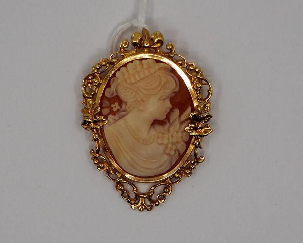 Broche / médaillon or jaune serti camée à décor de profil de femm...