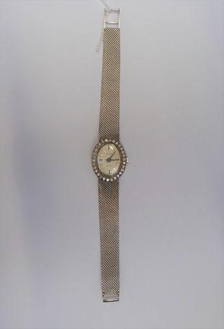 Montre or gris et diamants  Pds 34 grs
