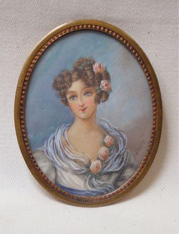 ECOLE FRANCAISE XIXème siècle Portrait d'élégante Miniature ovale...