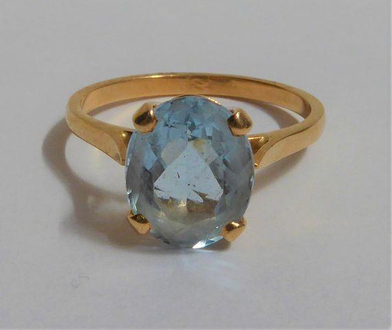 Bague or sertie pierre couleur bleu Pds 3 grs