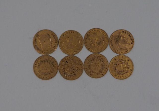 Lot de sept pièces de 10 francs or et une pièce de 10 lires or
