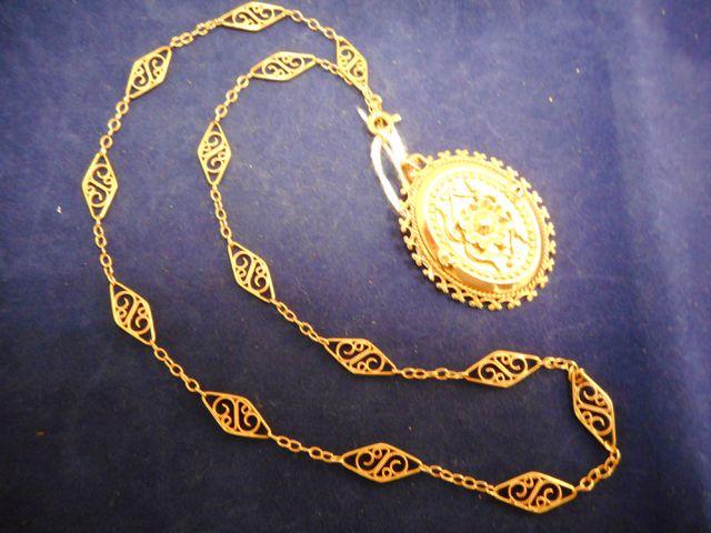 Collier or avec pendentif or 11,5g. 12 euros frais contrôle à raj...