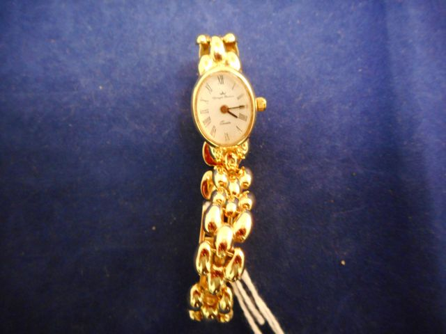 Yonger Bresson, montre dame or bracelet or, poids total 17g.
