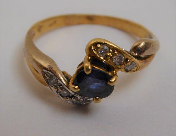 Bague or sertie pierres couleur bleu/blanc  Pds 4 grs